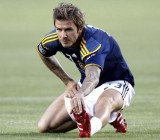 Los Angeles Galaxy midfielder David Beckham stretches before their MLS soccer match against Columbus Crew in Carson