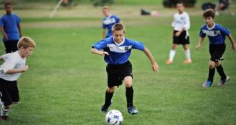 soccer-player-dribbling-soccer-ball