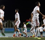 Syria's soccer squad warm up during training at Jalan Besar Stadium in Singapore