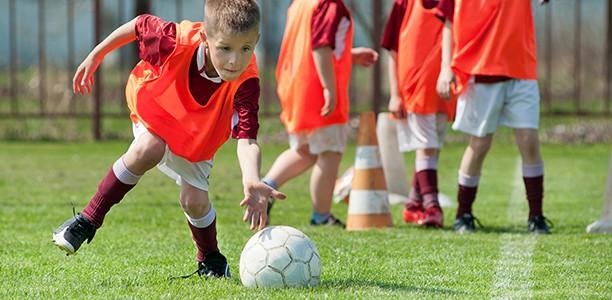 boy-practices-soccer-612x300