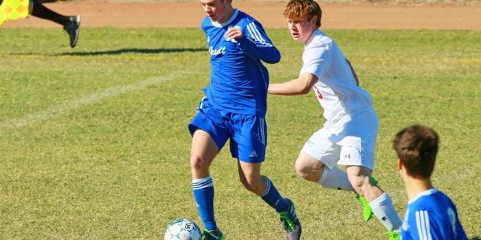 Sophomore Ashton Perkins dribbles towards the center of the field.